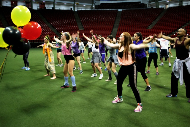 "Terps dancing for fitness in Cole Fieldhouse at ""Dance Through the Decades"""